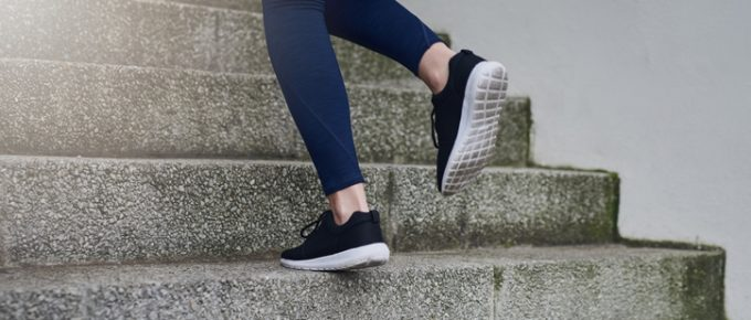 woman's feet running up steps